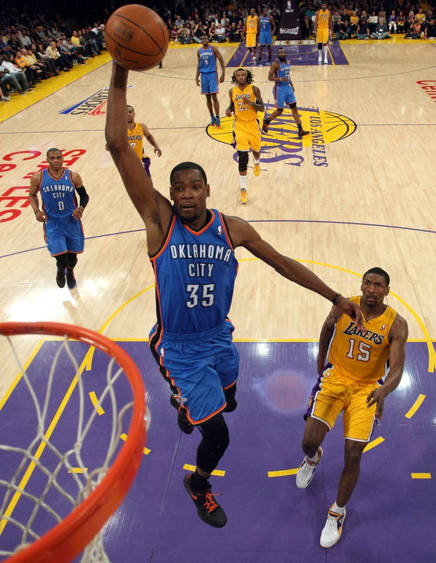 LOS ANGELES, CA - MAY 19:  Kevin Durant #35 of the Oklahoma City Thunder goes up for a dunk in front of Metta World Peace #15 of the Los Angeles Lakers in the first half in Game Four of the Western Conference Semifinals in the 2012 NBA Playoffs on May 19 at Staples Center in Los Angeles, California. NOTE TO USER: User expressly acknowledges and agrees that, by downloading and or using this photograph, User is consenting to the terms and conditions of the Getty Images License Agreement.  (Photo by Stephen Dunn/Getty Images)