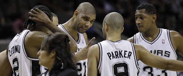 San Antonio Spurs' Tim Duncan (21_ talks with teammates during a timeout during the first quarter of Game 1 of an  NBA basketball Western Conference semifinal playoff series against the Los Angeles Clippers, Tuesday, May 15, 2012, in San Antonio. (AP Photo/Eric Gay)